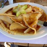 Pear-filled crepe with caramilized pecans and homemade caramel
