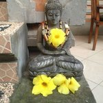 Mini Statue next to the staircase, always filled with fresh flowers as offerings
