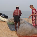sneaking out to the beach helping the fishermen clean the net