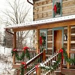 Log Cabin decorated for Christmas