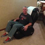 My hubby using the AWESOME massage chair!