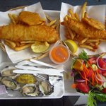 Fish, chips, potato scallops, oysters and salad