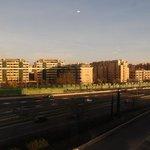 Sunrise over..major road and apartment blocks