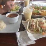 Fish tacos, pina coladas, nachos, and black bean soup from the bar and grill at the marina.
