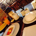 8 AM : Fresh orange juice, tea/coffee, pancakes, almond croissant, sliced fruit, bread, jam and