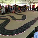 a replica of the track for the kids to race cars