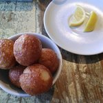 Fried bread balls!  Glazed in honey and tossed with sea salt!  Divine!