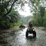 ATVing in the river