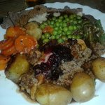 plate comes with meat of choice, rich  homemade stuffing & gravy, fresh vegetables are served to