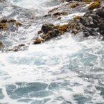 Water Splashing Against The Rocks.