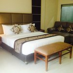 king bed with good mattress and soft sheets