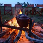 Pre-dawn fireside tea before going out on safari at Selinda Camp