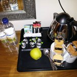 Tea tray with complimentary water and fruit