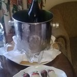 Sparkling wine and strawberries on arrival in room
