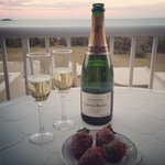 Enjoying champagne at sunset