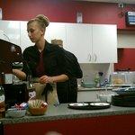 Becky prepares coffee