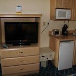 TV, microwave and mini fridge area.