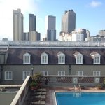 Rooftop heated pool with view of city