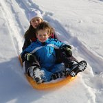 Sledding in front of the chalet