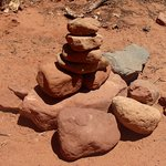pile of stones marking trail