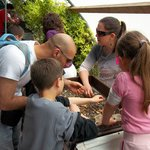 Visitors Participate in the Wet Sifting