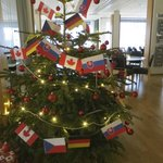 Creative staff decorated tree with flags of 4 hockey teams staying there for IIHF World Juniors.