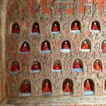 Little alcoves containing buddhist images