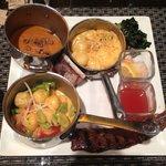 Sweet potato purée, gnocchi with favas, tomatoes and cream, Korean skirt steak, kale salad, agua