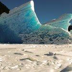XplorMor hiking across Mendenhall Lake when frozen to view Mendenhall Glacier