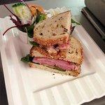 Roast honey glazed ham sandwich, with salad garnish and coleslaw