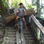Manoeuvring down steep stairs with rattan/bamboo at the back