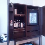 cabinet with coffee maker, fridge