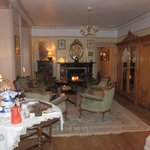 Sitting rooms with roaring fires
