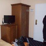 Room closet ,tv and fridge