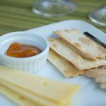 cheese and crackers with wine
