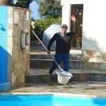 George cleaning his pool