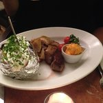 Rump steak with stewed onions, fried vine tomatoes, chili butter & Baked Potato