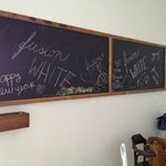 a huge blackboard in the dining area of the suite