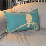 Comfy sofa with this charming pillow just waiting to cuddle a guest.  Just charming.
