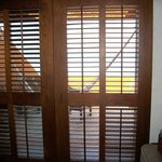 Louvered doors to room terrace.
