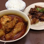 Chicken with candlenut curry and pork with tamarind sauce
