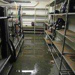 Boot room of boot shelves, Ski racks and waterlogged floor