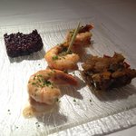 Sautéed shrimp and scallops in a butter ginger sauce with black rice and ratatouille