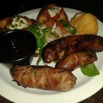 'Chukkas special' starter - mix of grilled sausages, fried goats cheese and bruschetta