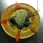 Ravioli al nero di seppia con lamelle di tartrufo nero e bottarga di muggine...