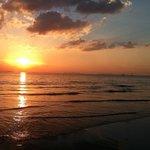 Beautiful walks along the beach at sunset