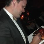 Tornado Steakhouse - Bob signing Wisconsin Supper Clubs by Ron Faiola
