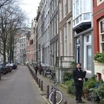 herengracht- with my friendly brother pointing to the b&b's front door