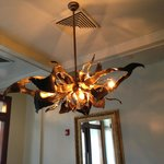 Loved this lobby light fixture. Sets the eclectic tone of modern and retro.