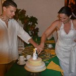 cutting the wedding cake at our villa